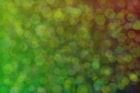 Abstract green background with gradient transitions and light spots. Soft bokeh