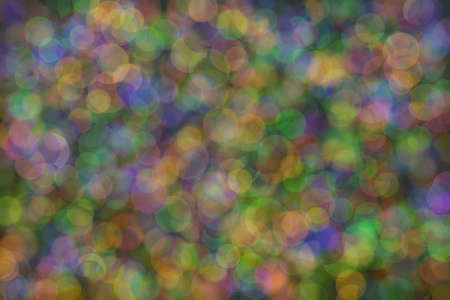 Abstract background of three colors: green, orange and blue and their mixture. Bokeh 版權商用圖片