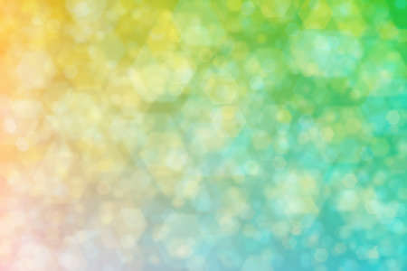 Abstract background with bokeh spots on gradient from cyan to yellow color nt their mixture.