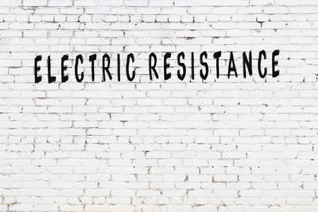 Chalk handwritten inscription electric resistance on black desk 스톡 콘텐츠