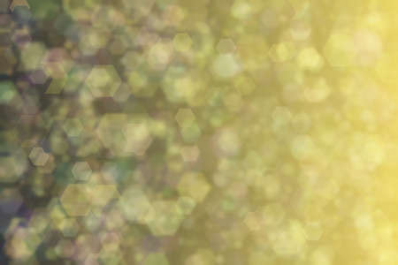 Bokeh on multi colored background with gradient transitions from yellow golden to dark colors. 스톡 콘텐츠