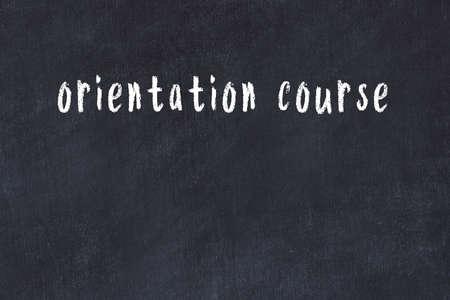 Chalk handwritten inscription orientation course on black desk 스톡 콘텐츠 - 168020011