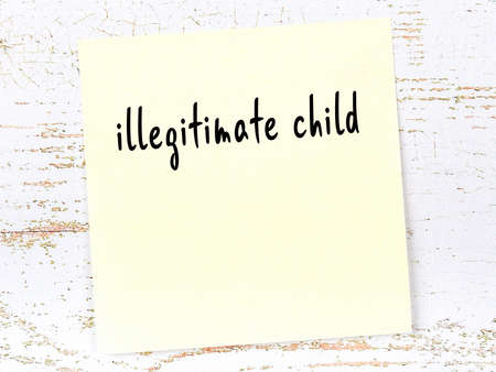 Yellow sticky note on wooden wall with handwritten inscription illegitimate child 스톡 콘텐츠 - 168020055