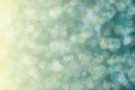 Warm to cold color transitions and defosused spots. Gradient with bokeh. Abstract background