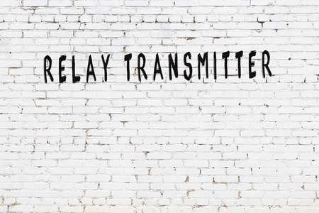 Chalk handwritten inscription relay transmitter on black desk 스톡 콘텐츠 - 168020066