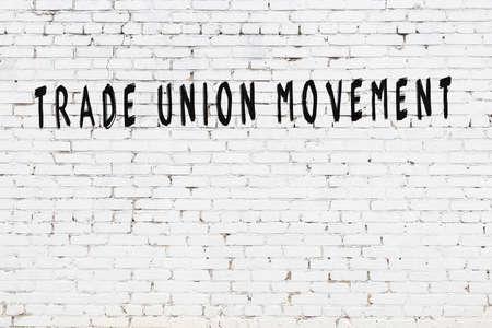 Chalk handwritten inscription trade union movement on black desk