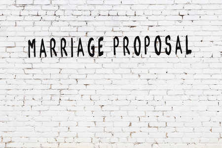 Chalk handwritten inscription marriage proposal on black desk 版權商用圖片