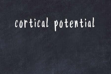 Chalk handwritten inscription cortical potential on black desk 版權商用圖片