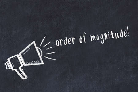 Black chalkboard with drawing of a loudspeaker and inscription order of magnitude