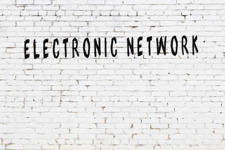 Chalk handwritten inscription electronic network on black desk