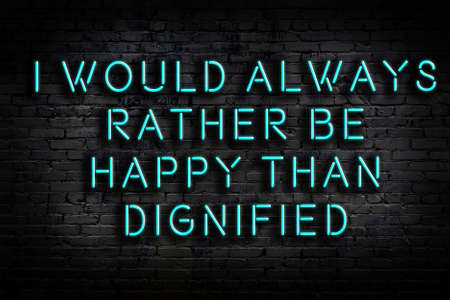 Smart and motivational quotation. Neon sign on brick wall in the darkness Standard-Bild