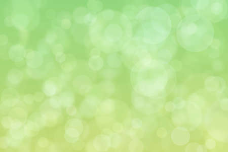 Light spots on green background. Abstract bokeh.