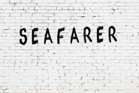White brick wall with inscription seafarer handwritten with black paint Zdjęcie Seryjne