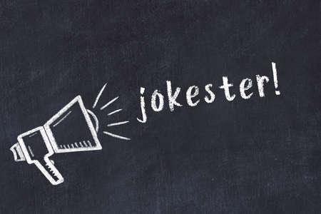 Chalk drawing of loudspeaker and handwritten inscription jokester on black desk 版權商用圖片