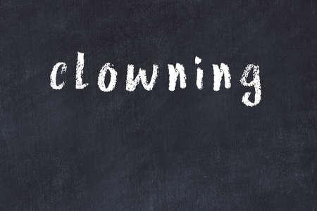 College chalkboard with with handwritten inscription clowning on it 版權商用圖片