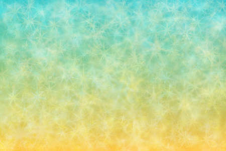 Background with gradients from yellow to cyan colors and star shaped bokeh spots on it.