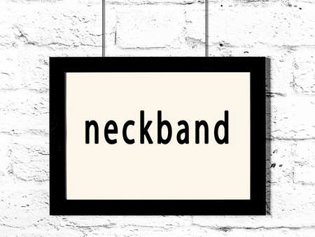 Black wooden frame with inscription neckband hanging on white brick wall