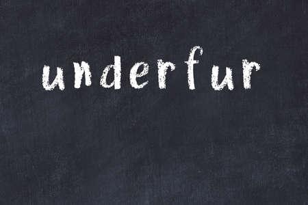 Chalk handwritten inscription underfur on black desk 版權商用圖片