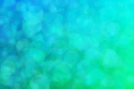 green and blue abstract defocused background with circle shape bokeh spots