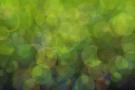 green and dark abstract defocused background with circle shape bokeh spots