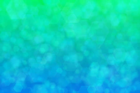 Abstract background with hexagon shaped pattern and dradient transition from blue to green.
