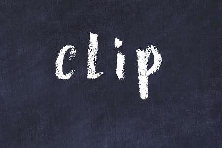 Chalk handwritten inscription clip on black desk 版權商用圖片