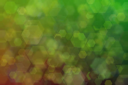 green and dark abstract defocused background with hexagon shape bokeh spots