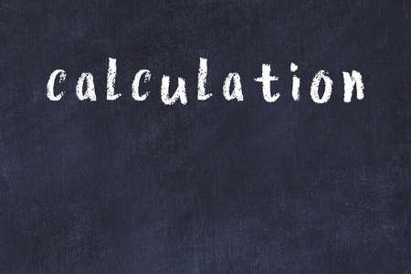 Chalk handwritten inscription calculation on black desk