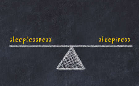 Balance between sleeplessness and sleepiness. Chalkboard drawing on black chalkboard