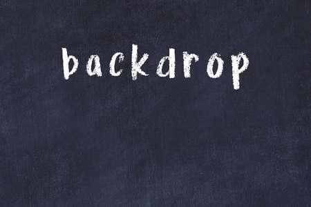 Chalk handwritten inscription backdrop on black desk