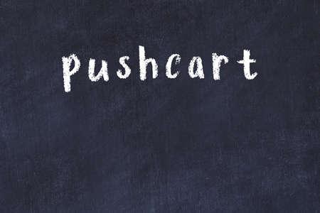 Chalk handwritten inscription pushcart on black desk 스톡 콘텐츠