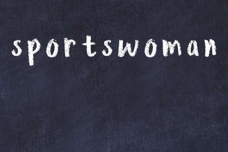 Chalk handwritten inscription sportswoman on black desk