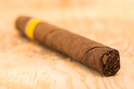 Cigar on a wooden board  Stock Photo