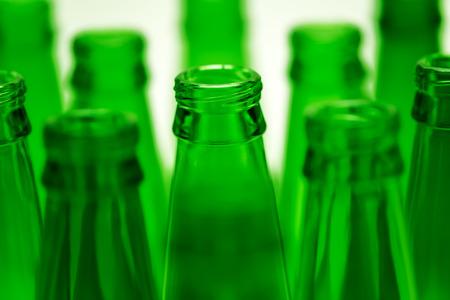 ten empty: Ten green empty beer bottles shot  One central bottles in focus
