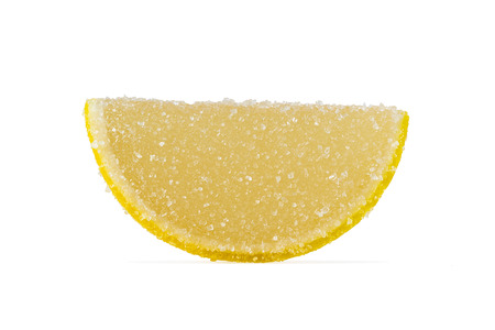 dulcet: Slice of yellow marmalade sprinkled with granulated sugar on a white background. Stock Photo