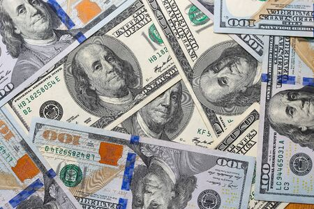 US dollars scattered randomly on the table, close up, background Archivio Fotografico