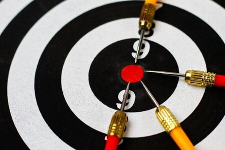 Target Darts. Red center, a dozen. Metaphor of success and achievement plans, background Фото со стока