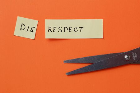The inscription on the sticker: DISRESPECT cut in half on an orange background
