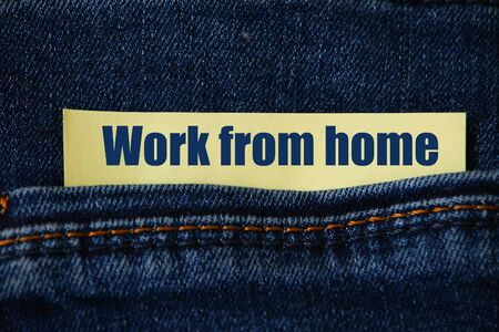 Denim background with an abstract inscription or text: Work from home