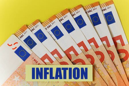 Sticker with text: Inflation on euro background Фото со стока