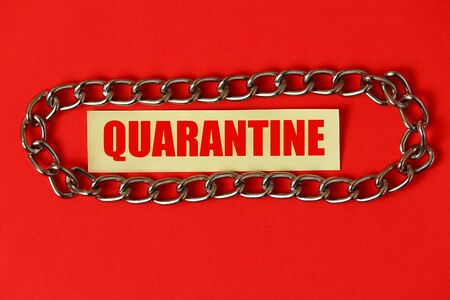 Sticker with the inscription: Quarantine , around a chain, on a red background