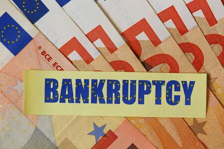 Sticker with text: Bankruptcy on euro background