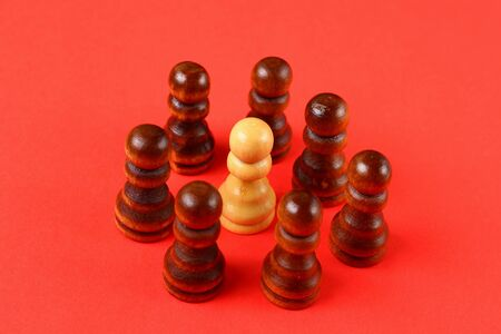 Abstract art concept of an ideological leader and organizer of management based on chess pawns 写真素材