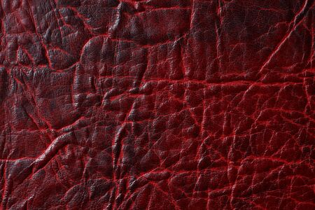 Dark texture of brown crumpled genuine leather, background, wallpaper, substrate, blank for design Foto de archivo