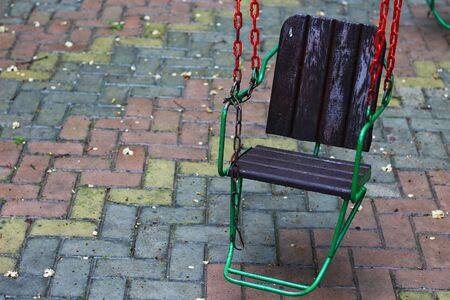 Swing on a chain in the playground. No one in the period of lockdown