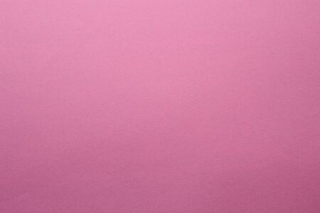 Blank textured sheet of colored paper to place the inscription or text background. Pink color