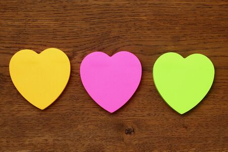 Three blank heart shaped stickers with space for text. Creative symbolic background on the theme of love