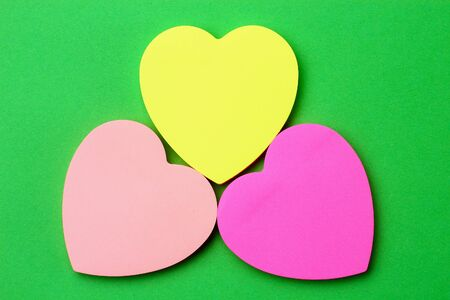 Three blank heart shaped stickers with space for text. Creative symbolic background on the theme of love Stok Fotoğraf