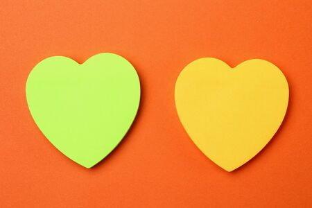 Two blank heart shaped stickers with space for text. Creative symbolic background on the theme of love