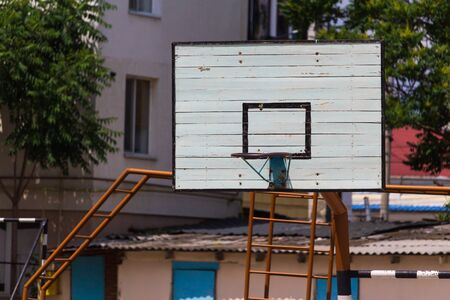 Basketball wooden backboard with a ring on an indoor yard. Background Banque d'images